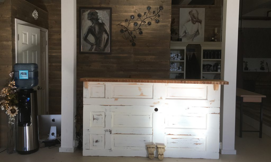 Gary Hecht Woodworker Custom Distressed Built-In Front Desk from Reclaimed Doors
