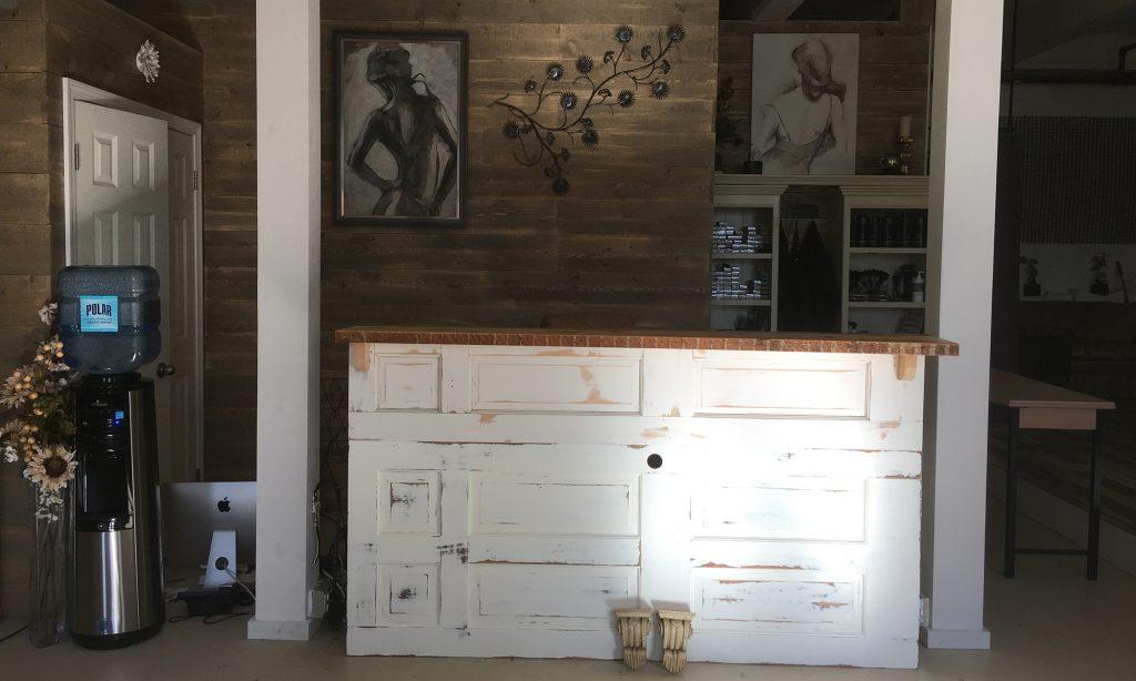 Gary Hecht Woodworker Custom Distressed Built-In Front Desk from Reclaimed Doors